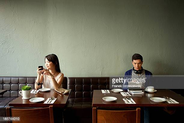 young woman and young man in restaurant - stranger stock pictures, royalty-free photos & images