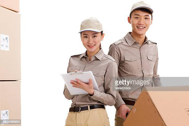 Young woman and young man in warehouse