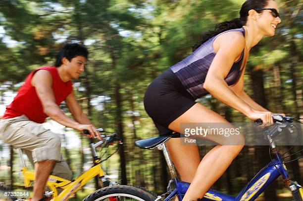 Young woman and young man on mountain bike