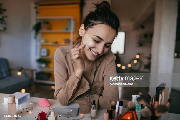 young woman applying daily cream - make up stock pictures, royalty-free photos & images