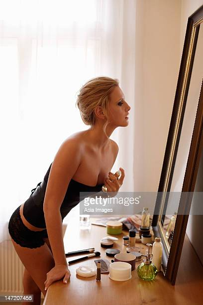 young woman applying perfume - beautiful czech women stock photos and pictures