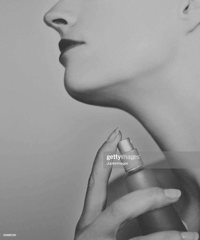 Young Woman Applying Perfume : Stock Photo