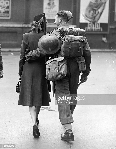 A young woman arriving to see her soldier boyfriend off from a London railway station 17th June 1940