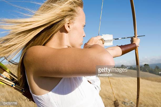 Young woman arrow shooting