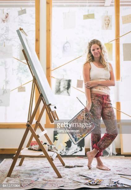 Young woman artist in her studio