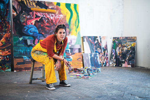 Young woman artist in studio. 1187482560