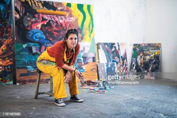 young woman artist in studio. - art stock pictures, royalty-free photos & images