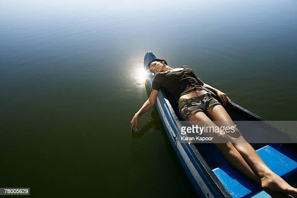 Young woman asleep in Canoe.