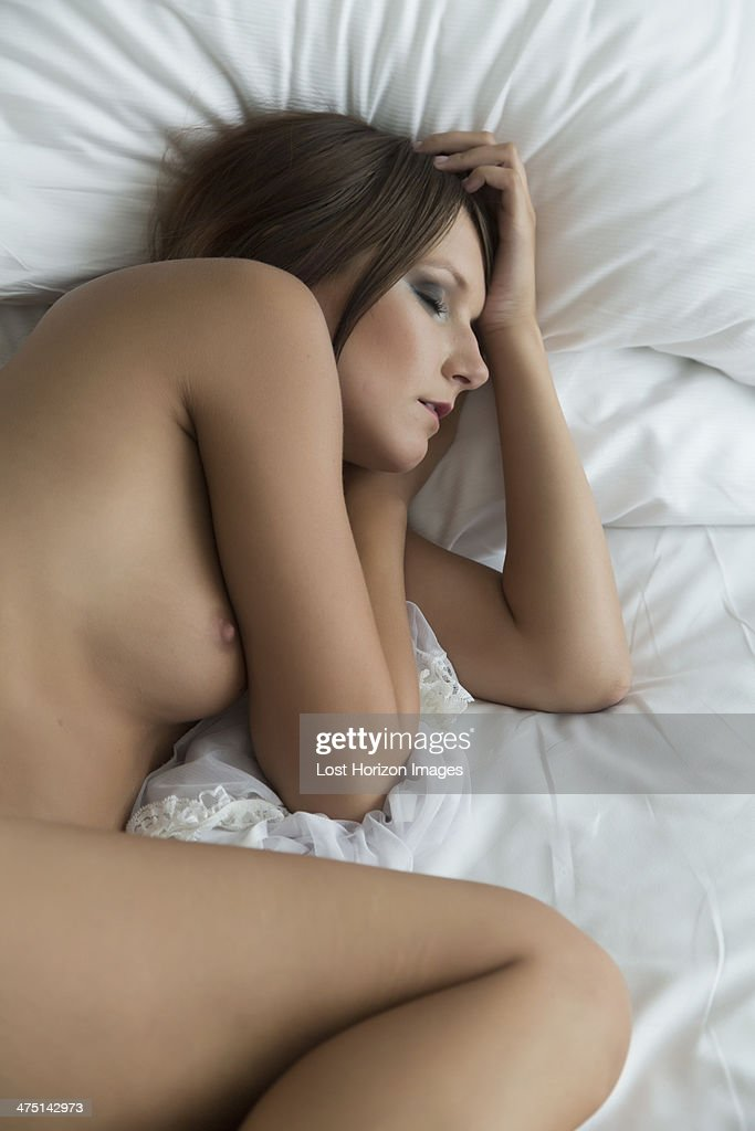 naked young girl sleeping on bed