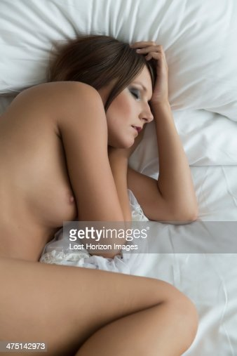 Young Woman Asleep On Bed Naked Stock Photo  Getty Images-8260