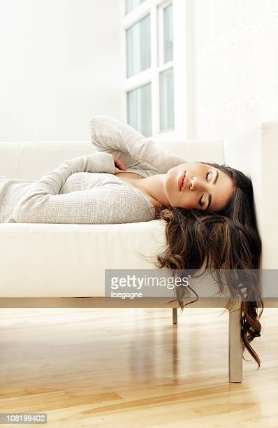 Young Woman Asleep on Couch