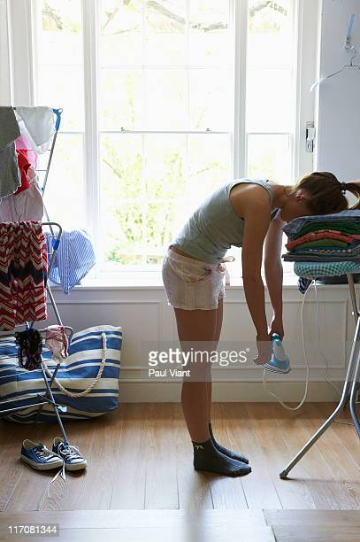 young woman asleep while ironing