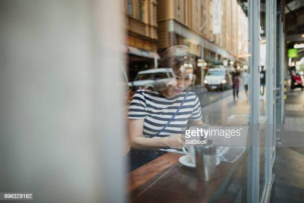 Young Woman at a Coffee Shop