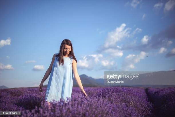 young woman at a lavender field - purple dress stock pictures, royalty-free photos & images