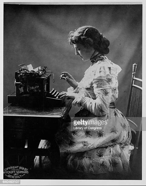 A young woman at a typewriter