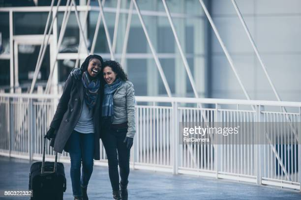 Young woman at airport meeting friend