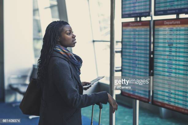 young woman at airport - flying stock photos and pictures