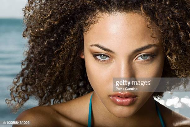 Young woman at beach, portrait, close-up