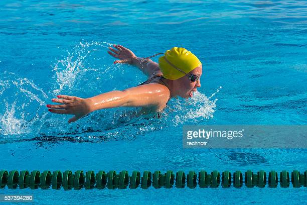 Young woman at butterfly stroke
