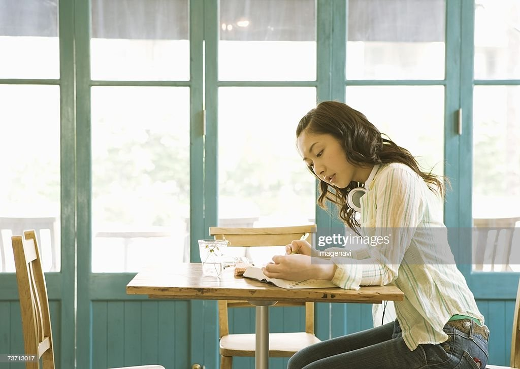 Young woman at cafe : Photo