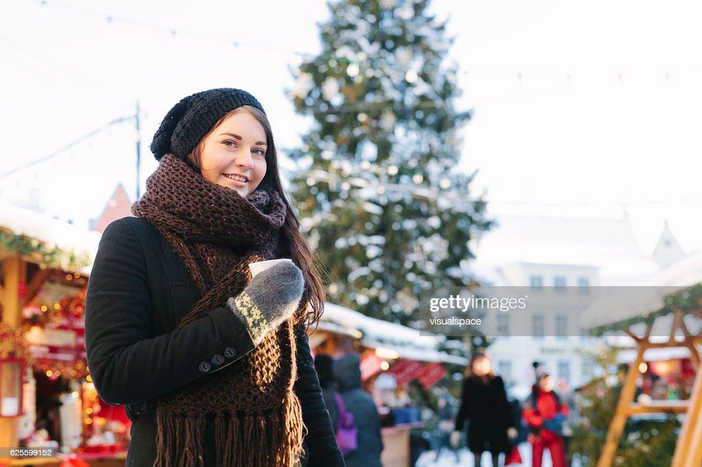 Young Woman at Christmas Market : Stock Photo