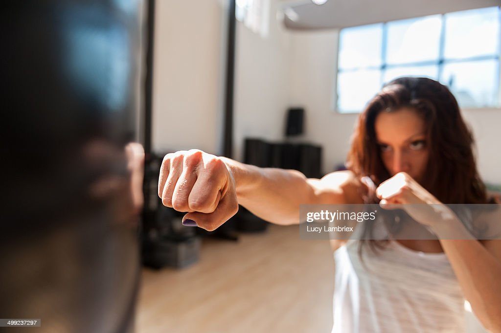 Young woman at gym boxing : Stock Photo