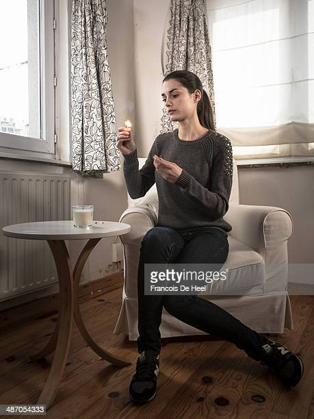 Young woman at her apartment in Brussels