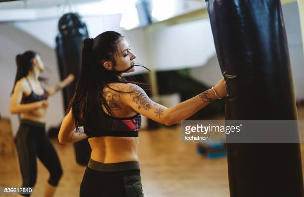 young woman at her boxing training - human arm foto e immagini stock