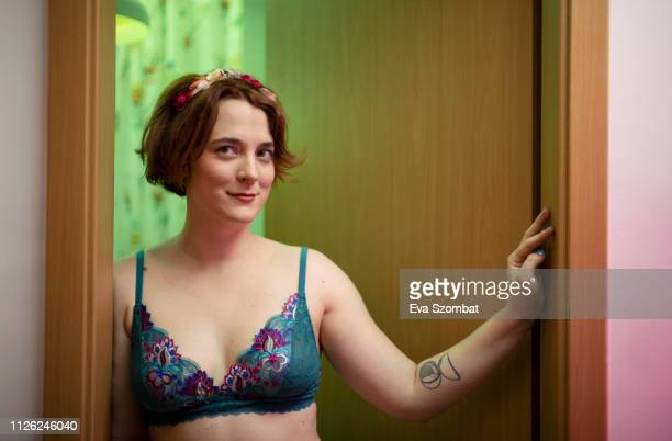 young woman at home in bra - bras stock pictures, royalty-free photos & images