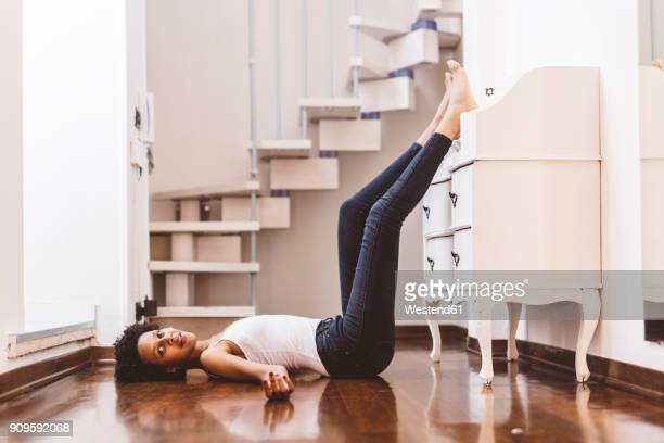 young woman at home lying on the floor - woman flat chest stock photos and pictures