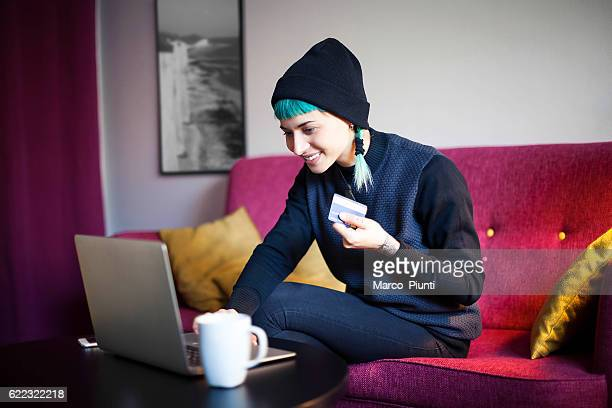 young woman at home - online shopping - black friday stock photos and pictures