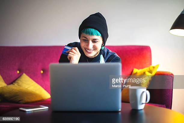 Young woman at home - Online Shopping