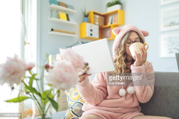 young woman at home - pajamas stock pictures, royalty-free photos & images