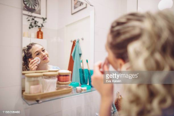 young woman at home - routine stock pictures, royalty-free photos & images