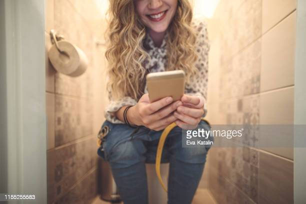 young woman at home - toilet stock pictures, royalty-free photos & images