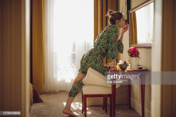 young woman at home - lip balm stock pictures, royalty-free photos & images