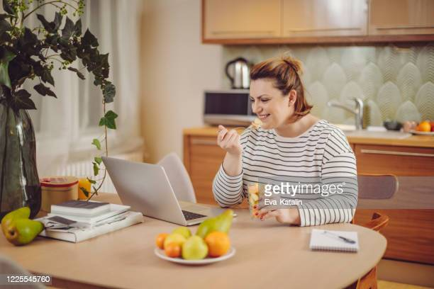 young woman at home - fat nutrient stock pictures, royalty-free photos & images