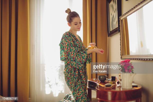 young woman at home - perfume stock pictures, royalty-free photos & images