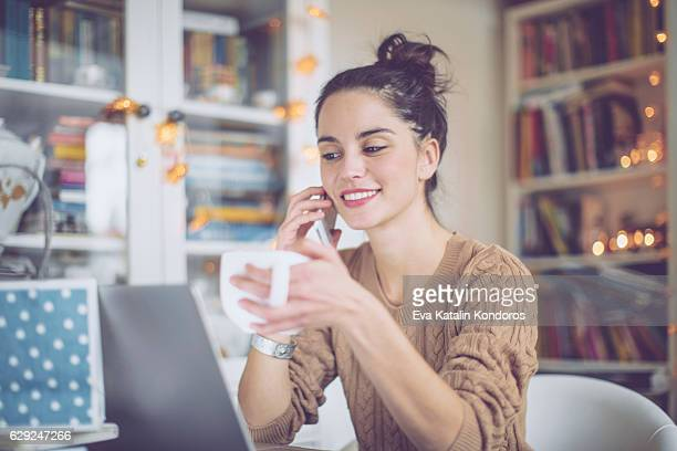 young woman at home - beige stock pictures, royalty-free photos & images