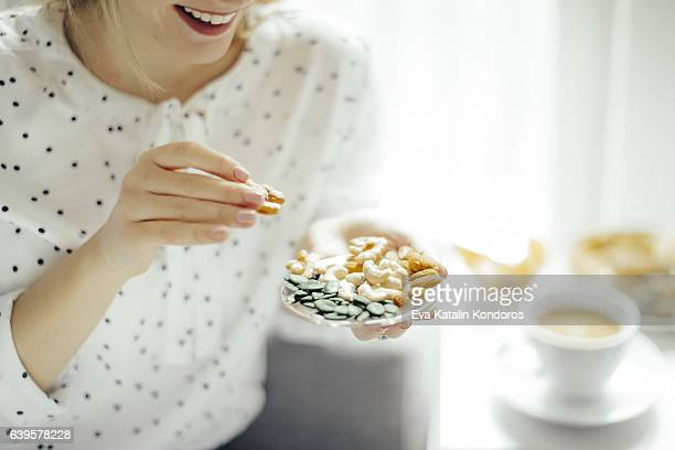 young woman at home - nut food stock pictures, royalty-free photos & images