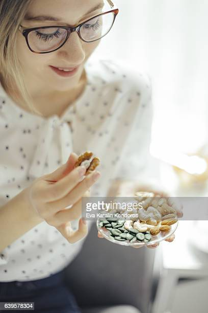 young woman at home - nut food stock photos and pictures