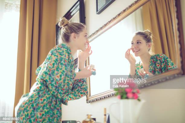 young woman at home - girl in mirror stock photos and pictures