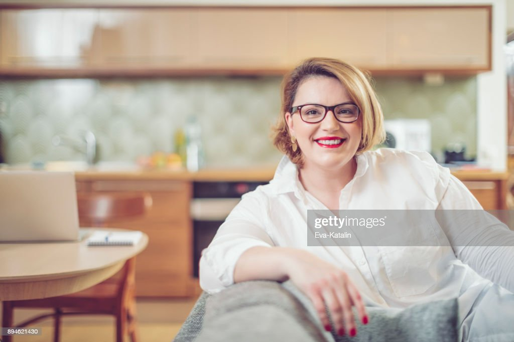 young woman at home stock photo getty images rh gettyimages co uk woman at home smoked salmon pate recipe woman at home bread pudding