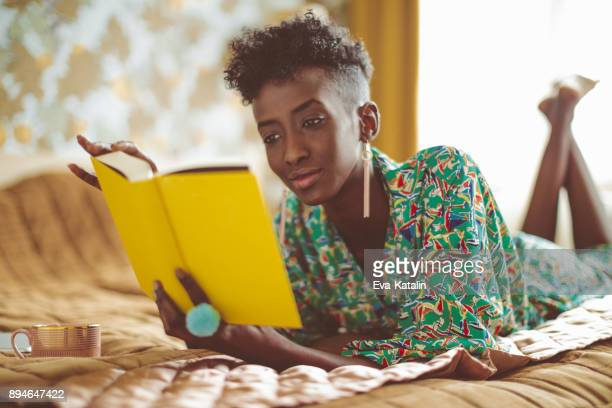 young woman at home - reading stock pictures, royalty-free photos & images