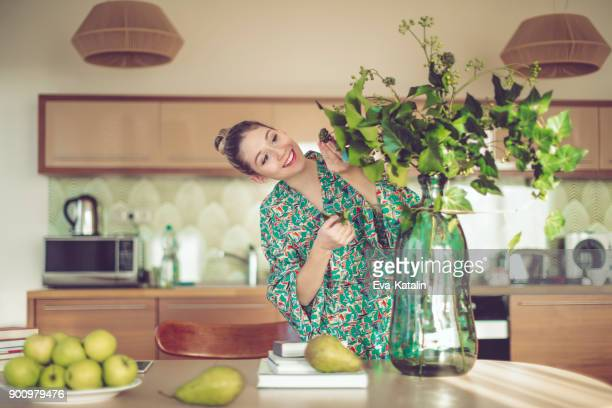 young woman at home - ikebana stock pictures, royalty-free photos & images