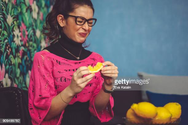 young woman at home - sour taste stock pictures, royalty-free photos & images