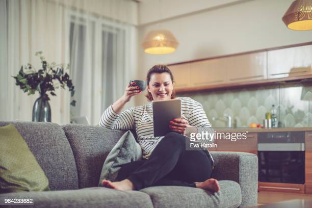 young woman at home - chubby stock pictures, royalty-free photos & images