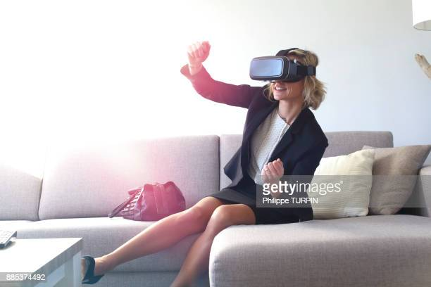 Young woman at home using virtual mask