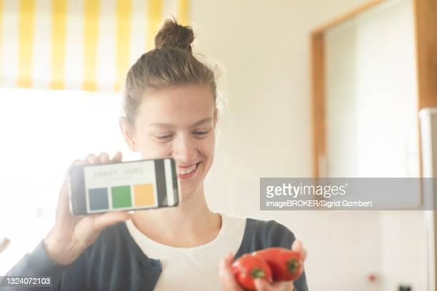 young woman at home working with smart home technology, freiburg, baden-wuerttemberg, germany - sigrid gombert stock-fotos und bilder