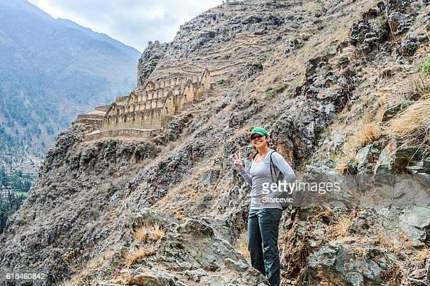 Young woman at Inca Ruins in Peru - Ollantaytambo Fortress
